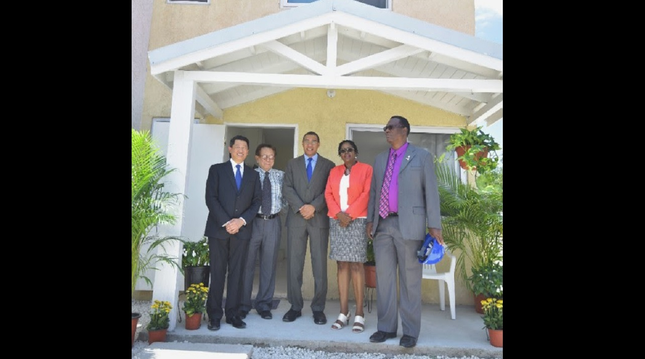 Prime Minister Andrew Holness (centre) with (from left) William and Eddie Lai of World Homes Jamaica Ltd, Angela Brown-Burke, MP, and Karl Blake, Councillor.