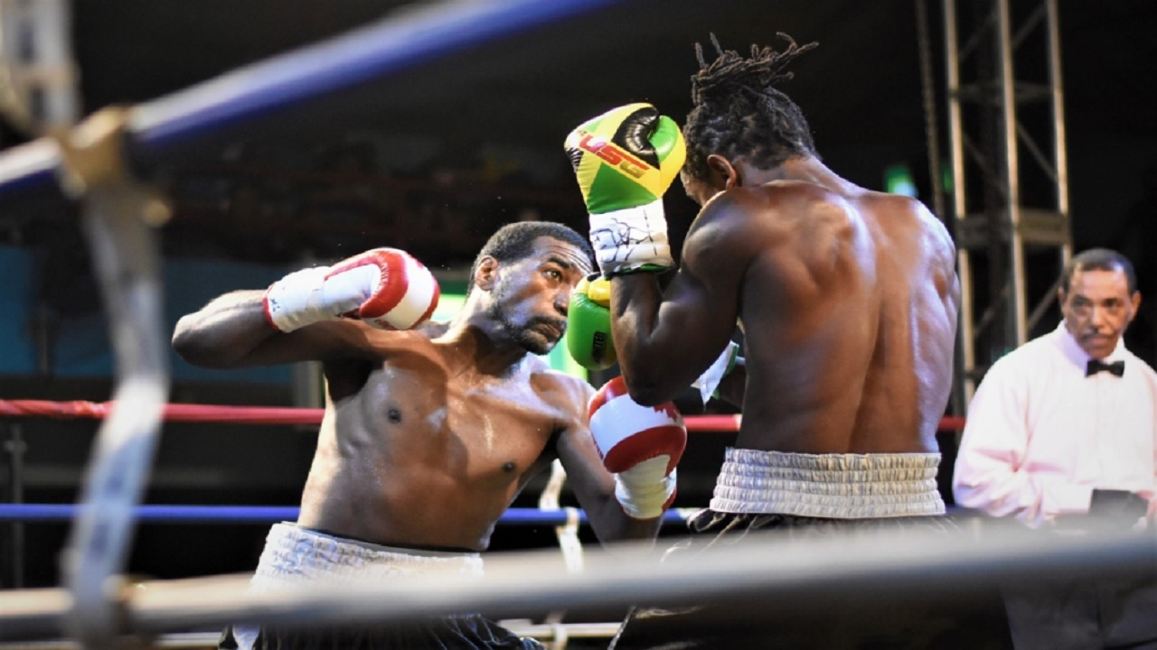 Jamaica's number one seed, Richard 'Frog' Holmes (right) and Canadian  Lloyd Reyes in action in the opening bout of the 2018 Wray and Nephew Contender Series last week. (PHOTO: Marlon Reid).