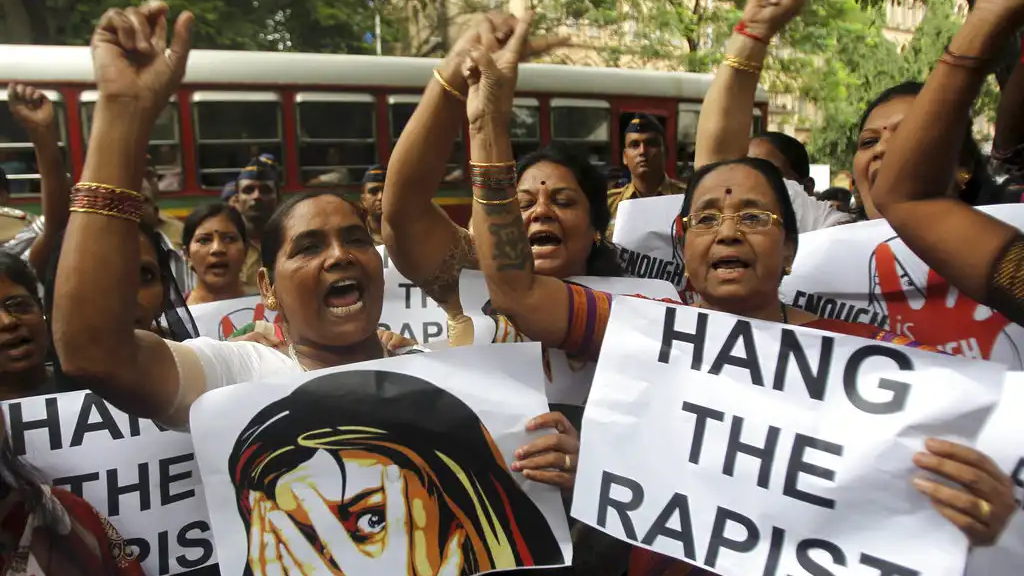 FILE - In this Aug 23, 2013 file photo, Indian activists hold placards demanding rapists be hanged as they protest against the gang rape of a 22-year-old woman photojournalist in Mumbai India. (AP Photo/Rafiq Maqbool, File)