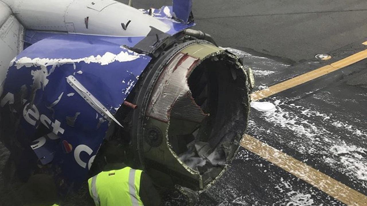 (Image: AP: The damaged engine of the Southwest plane)