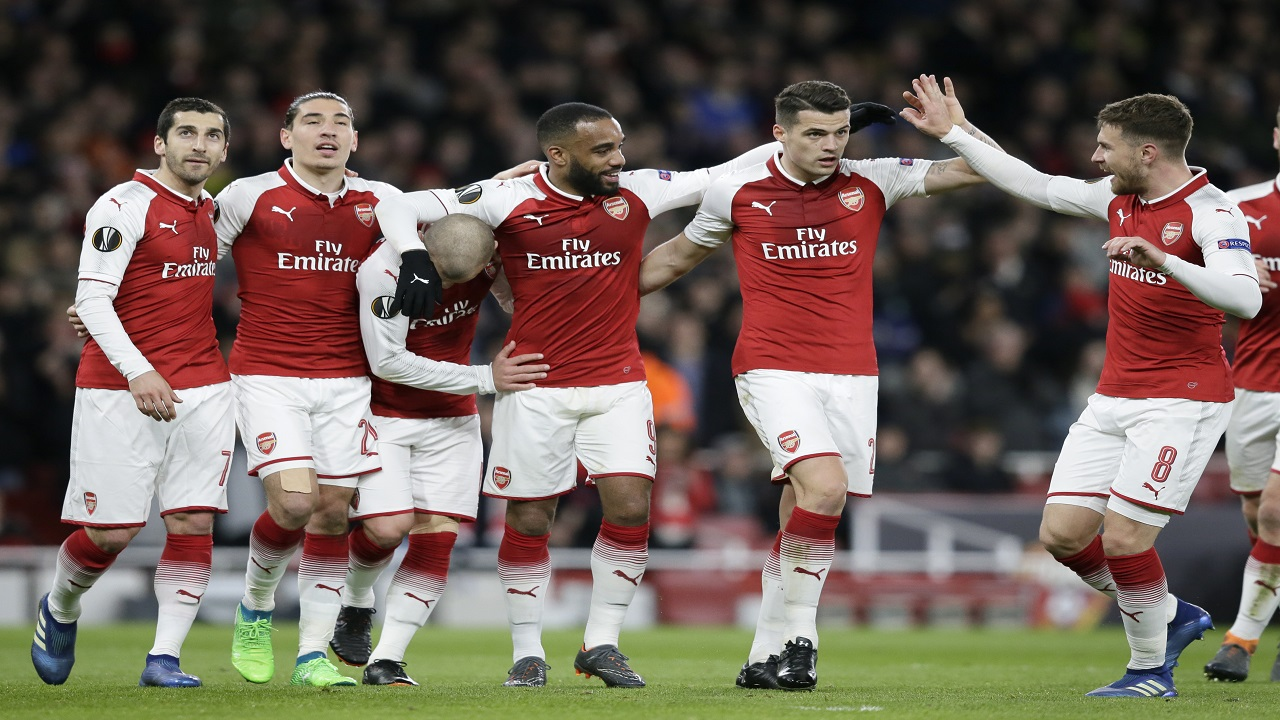 Arsenal's Alexandre Lacazette, 3rd left, celebrates with teammates after scoring his sides fourth goal during the Europa League quarterfinal, first leg football match against CSKA Moscow at the Emirates stadium in London Thursday, April 5, 2018.