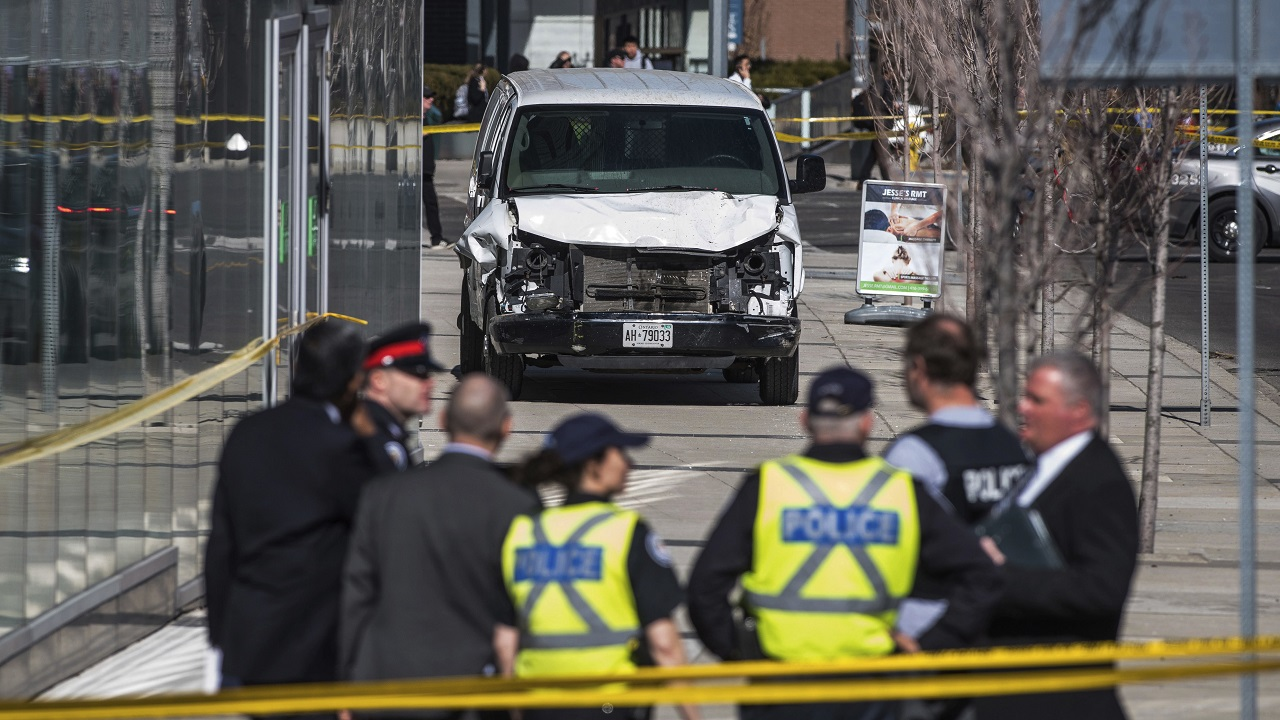 (Image: AP: Police are seen near the damaged van on 23 April 2018)