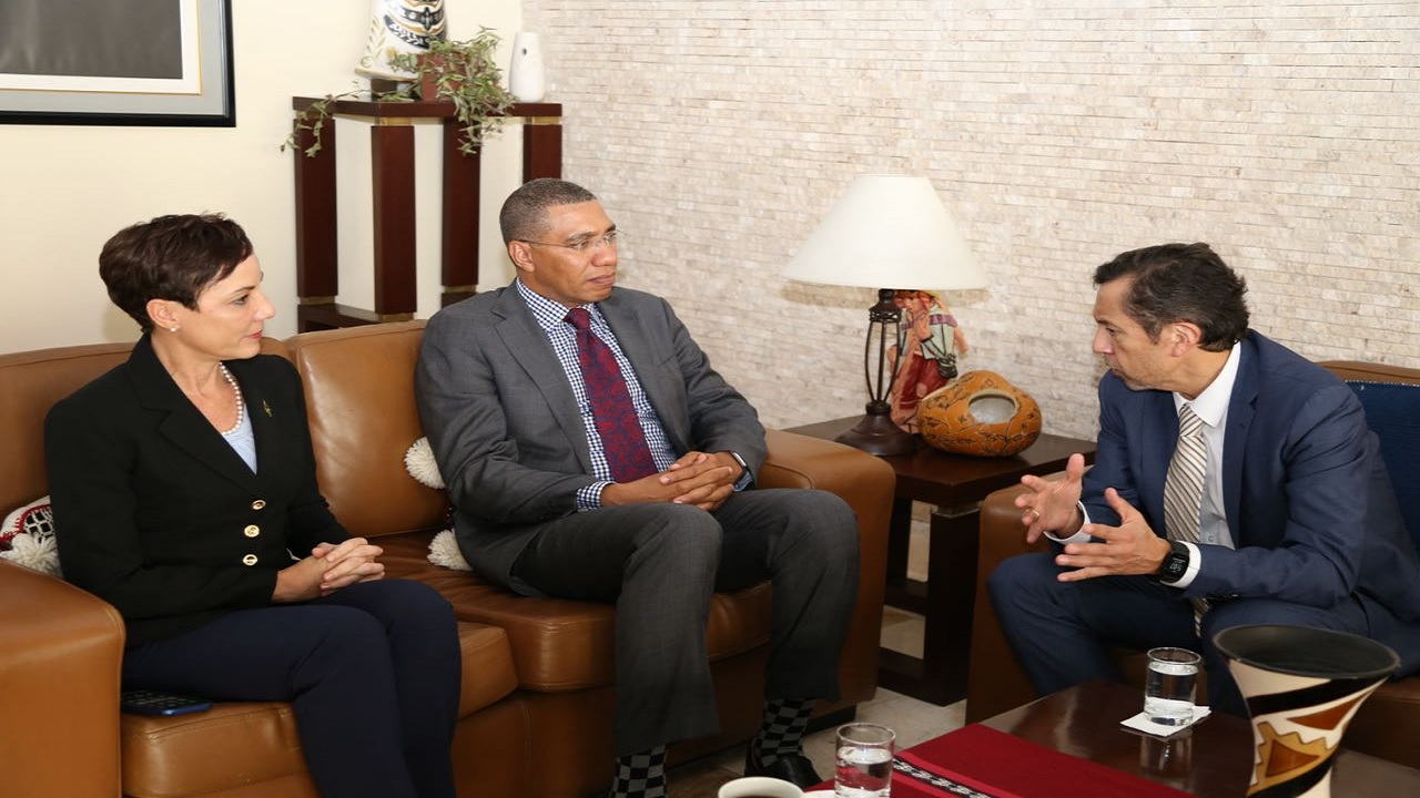 Jamaican Prime Minister Andrew Holness (centre) and Foreign Affairs Minister, Senator Kamina Johnson Smith, meet with David Tuesta Cardenas, Peruvian Minister of Economy and Finance in Lina, Peru during the Summit of the Americas. (PHOTO: Twitter)