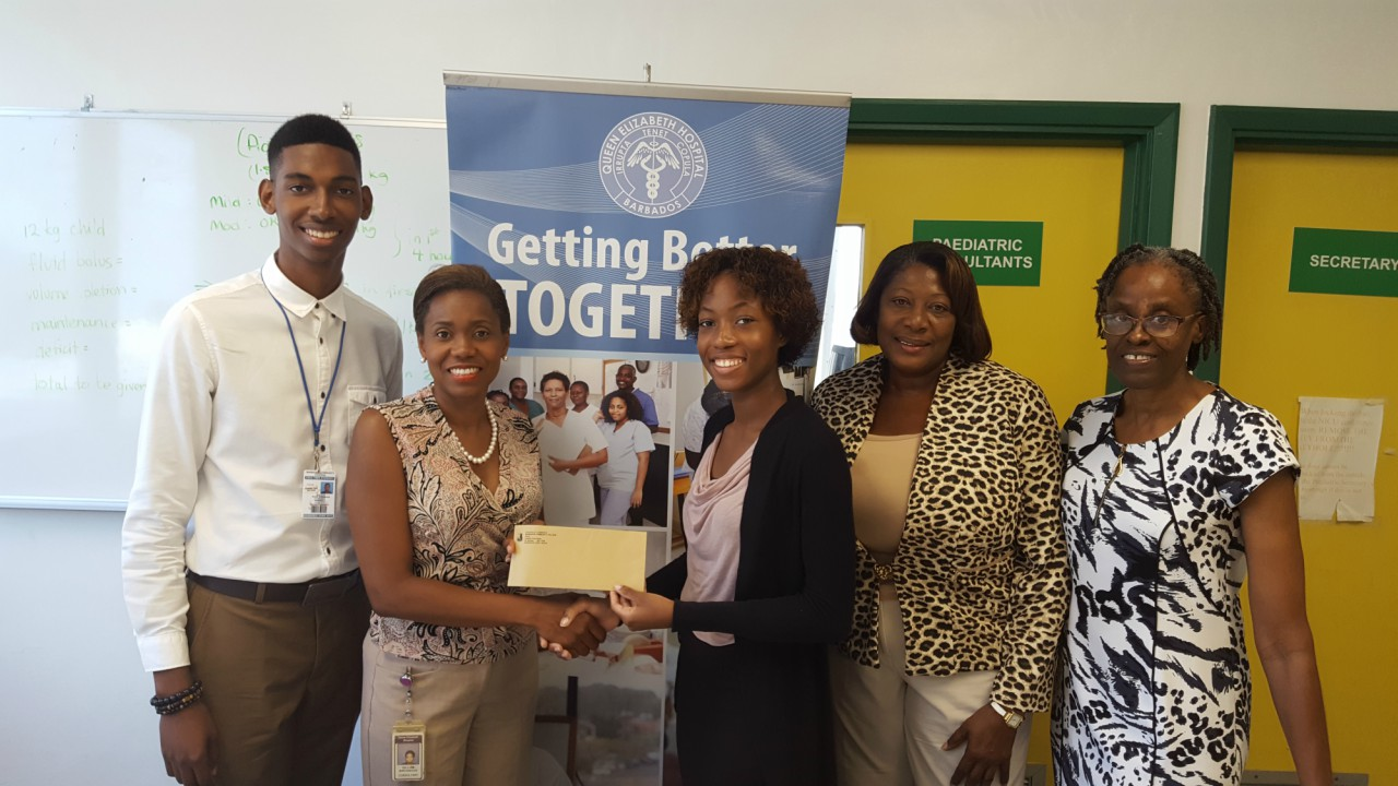 (L-R) President of the Students   Guild Kobie Broomes; Dr.Birchwood, Student, Zharia Springer;Principal Dr.Cheryl Weekes and Senior Tutor (Ag) Commerce Patrica Gall.