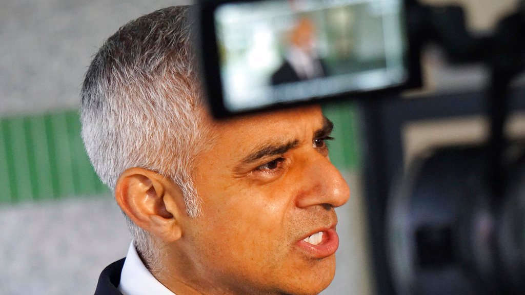 Mayor of London Sadiq Khan speaks to reporters at the London Ambulance Service headquarters at Waterloo, central London, Tuesday June 6, 2017. (AP Photo/Raphael Satter)