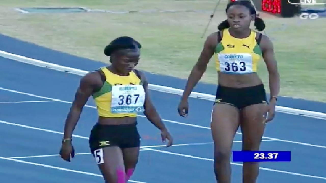 Jamaican sprinters Ockera Myrie (left) and Donna-Ray Lee following the Girls' Under 20 200m final on Monday at the Carifta Games in the Bahamas. Myrie, of Petersfield High, won the race easily in 23.34, while Lee finished fourth in 23.88.