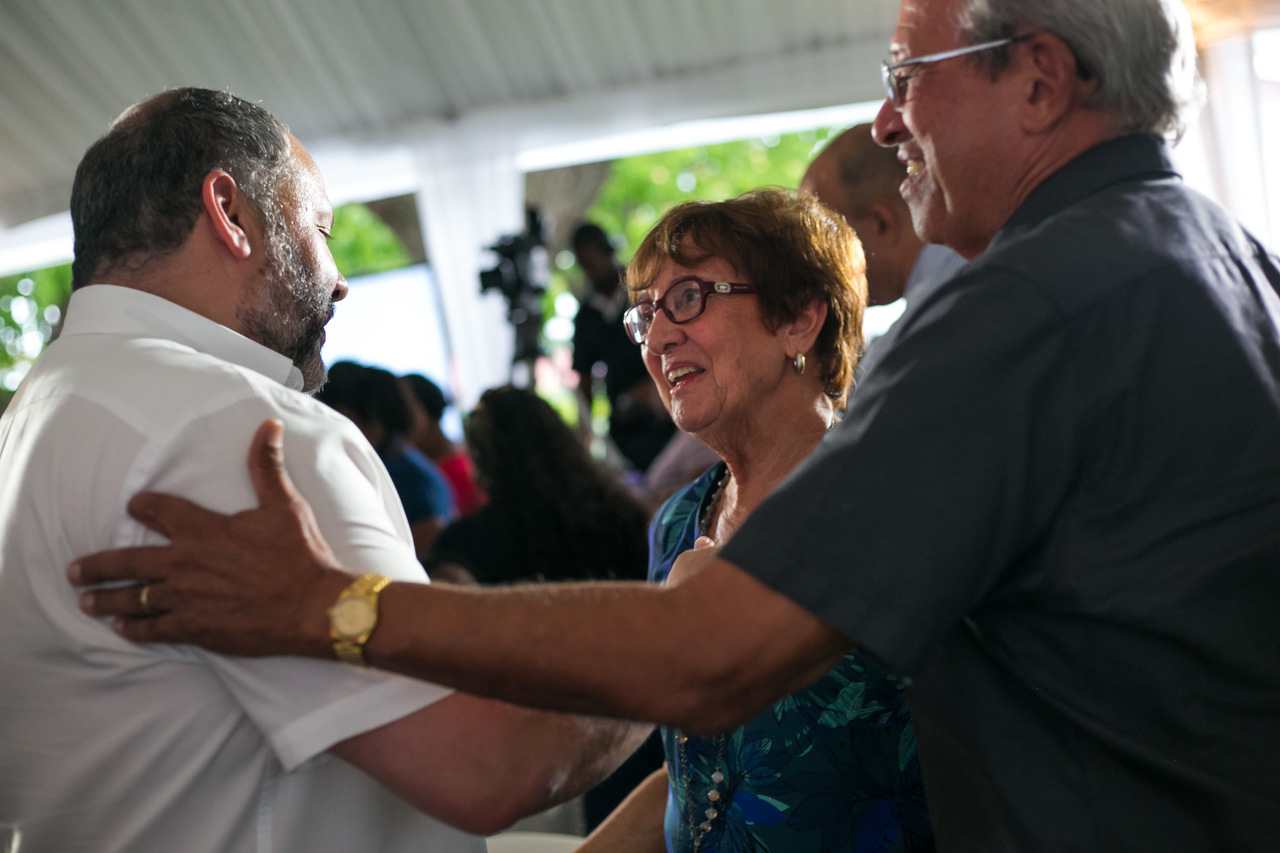 Mark Myers (left), managing director of Restaurants of Jamaica, operators of KFC and Pizza Hut is welcomed to the Jamaica Broilers Group's recent Thanksgiving Service at McCook's Pen, St. Catherine, by Robert Levy (right), Chairman of JBG and his wife Judy.