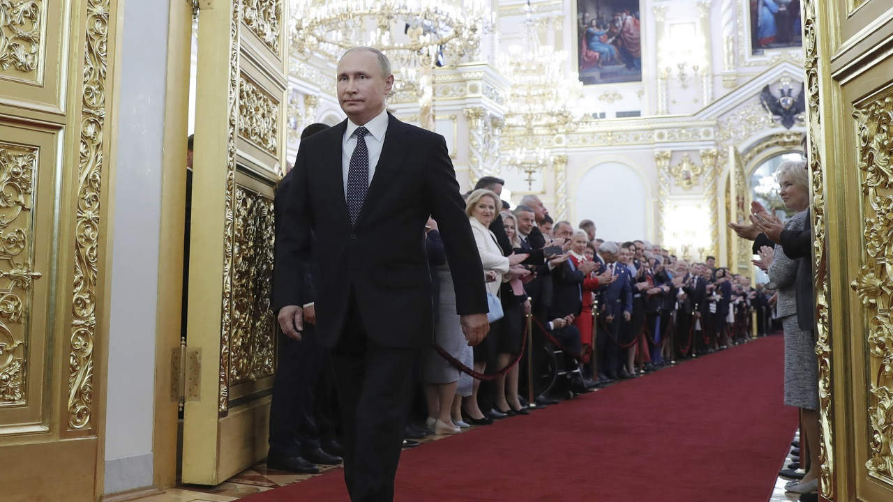 (Image: AP: Vladimir Putin is applauded as he walks into the hall for his inauguration on 7 May 2018)