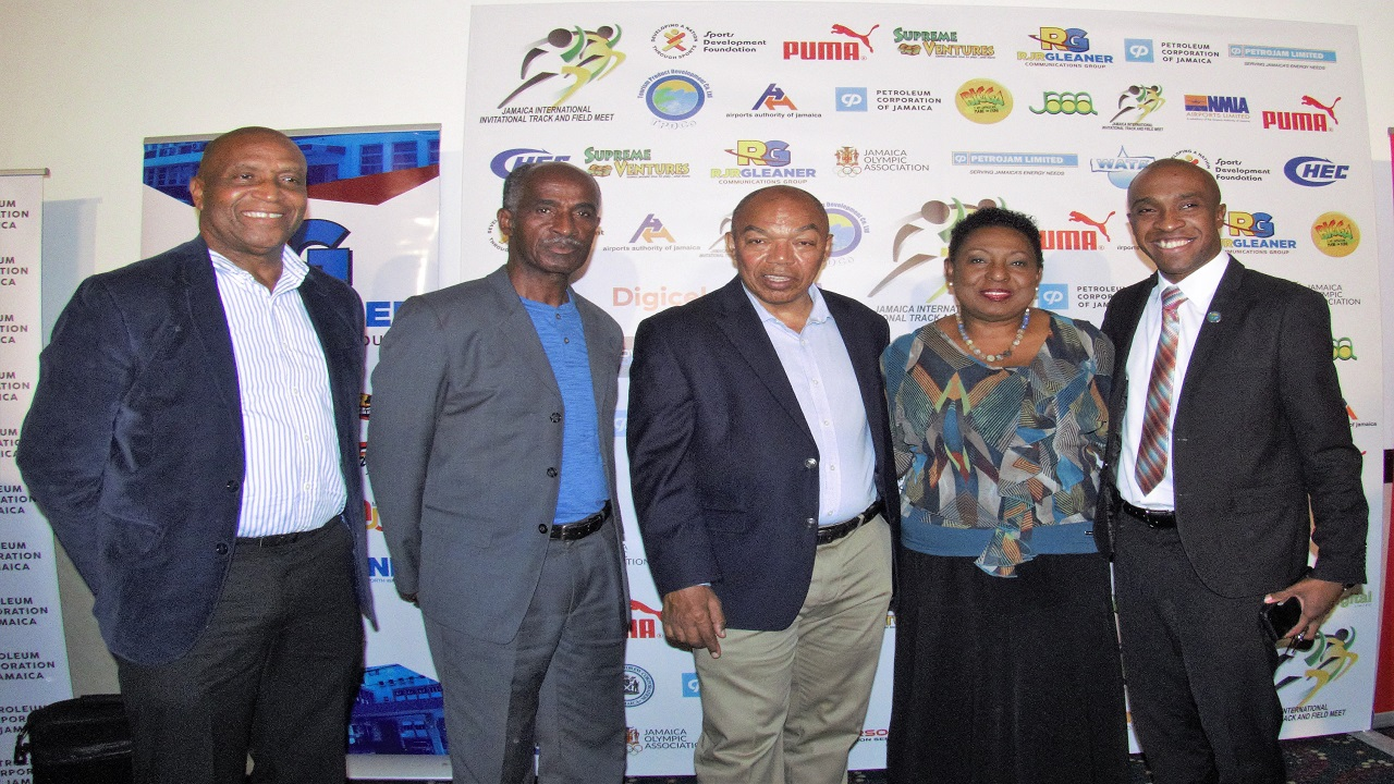 Executive Director, Tourism Product Development Company Limited (TPDCo) Dr Andrew Spencer (right) joins (2nd right – left) Sports Minister Olivia Grange; Chairman of the organising committee, Jamaica International Invitational Track Meet (JIIM) Dr Warren Blake; Director of the JIIM Donald Quarrie and Vice-Chairman of the organising committee, JIIM, Ludlow Watts. The occasion was the press launch for the JIIM on Wednesday at the Jamaica Pegasus in Kingston.