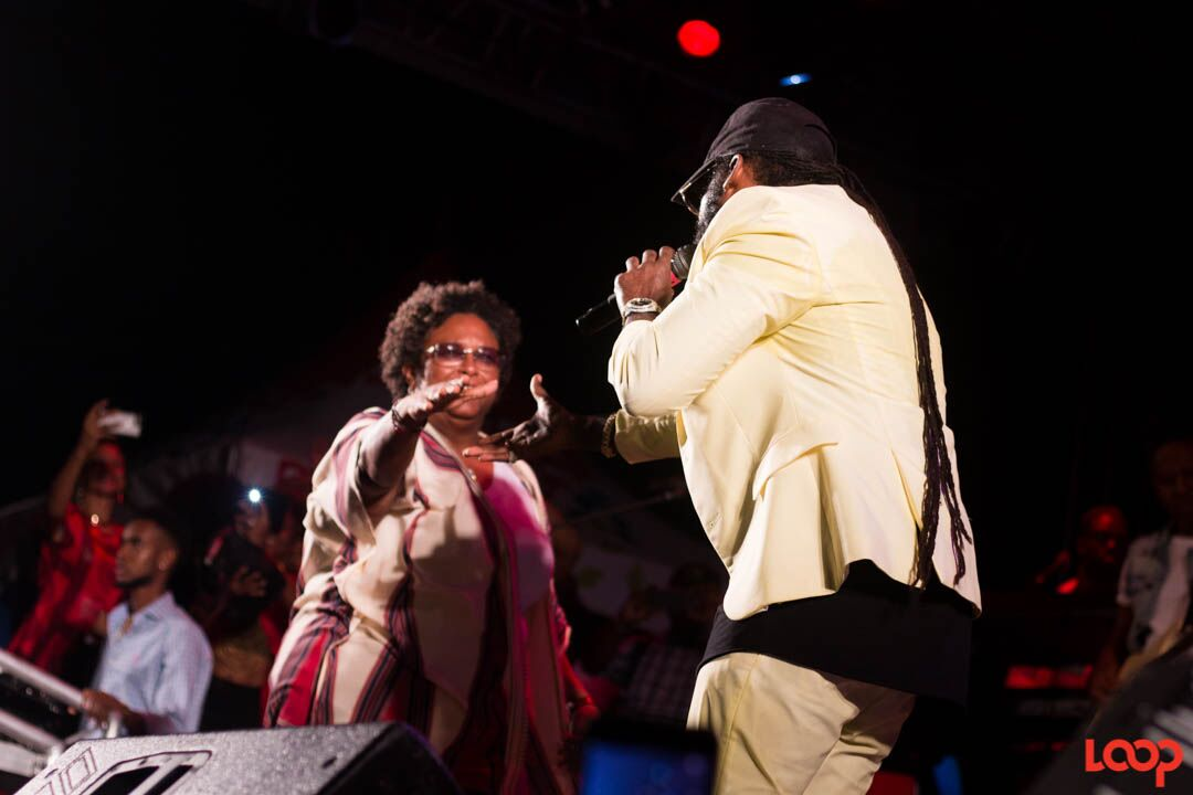 Opposition Leader, Mia Mottley (left) and Jamaican reggae artiste, Tarrus Riley (right).