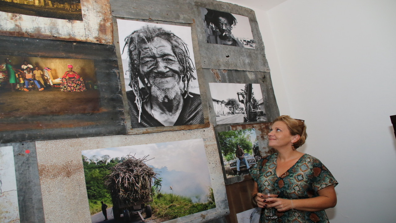 Marina Burnel looking at some of her pieces at an exhibition held at the St Andrew residence of the French Ambassador to Jamaica last Wednesday. (PHOTOS: Llewellyn Wynter)