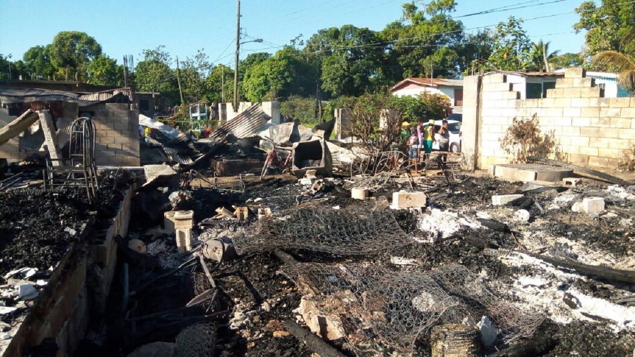 The charred remains of a shop and several dwelling houses in a section of Grange Hill, Westmoreland, which was attacked by gunmen on Tuesday and burnt in a deadly feud that was played out in several other sections of the community.