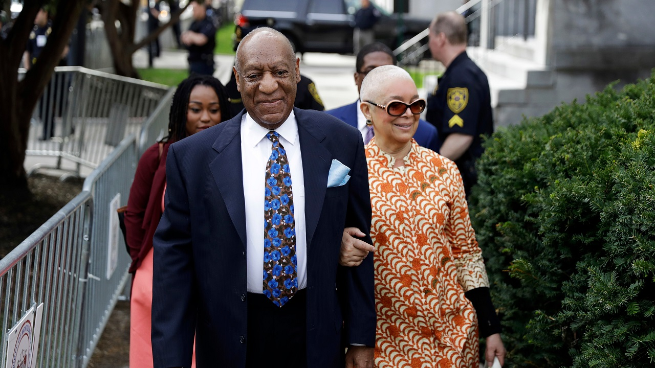 (Image: AP: Bill Cosby and his wife, pictured outside court on 26 April 2018)