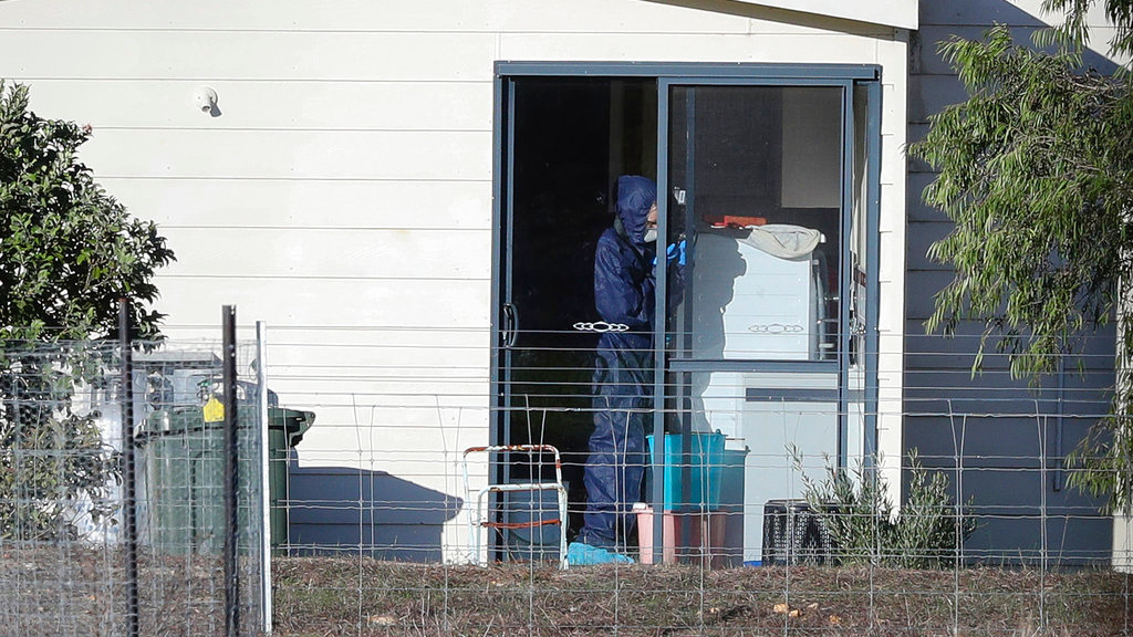 Police forensics investigate the death of seven people in a suspected murder-suicide in Osmington, east of Margaret River, south west of Perth, Australia Friday, May 11, 2018. Seven people including four children were found dead with gunshot wounds Friday at a rural property in southwest Australia in what could be the country's worst mass shooting in 22 years, police said.