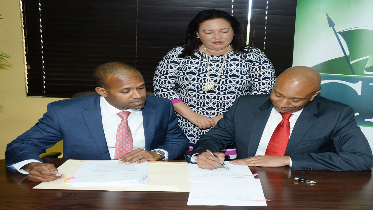 CPJ CEO, David Lowe (right), signs the transactions documents for the recently closed Notes offer, arranged by Scotia Investments Jamaica. Observing is Dylan Coke (left) VP Origination & Capital Markets at Scotia Investment, and Jan Polack (centre), CFO.