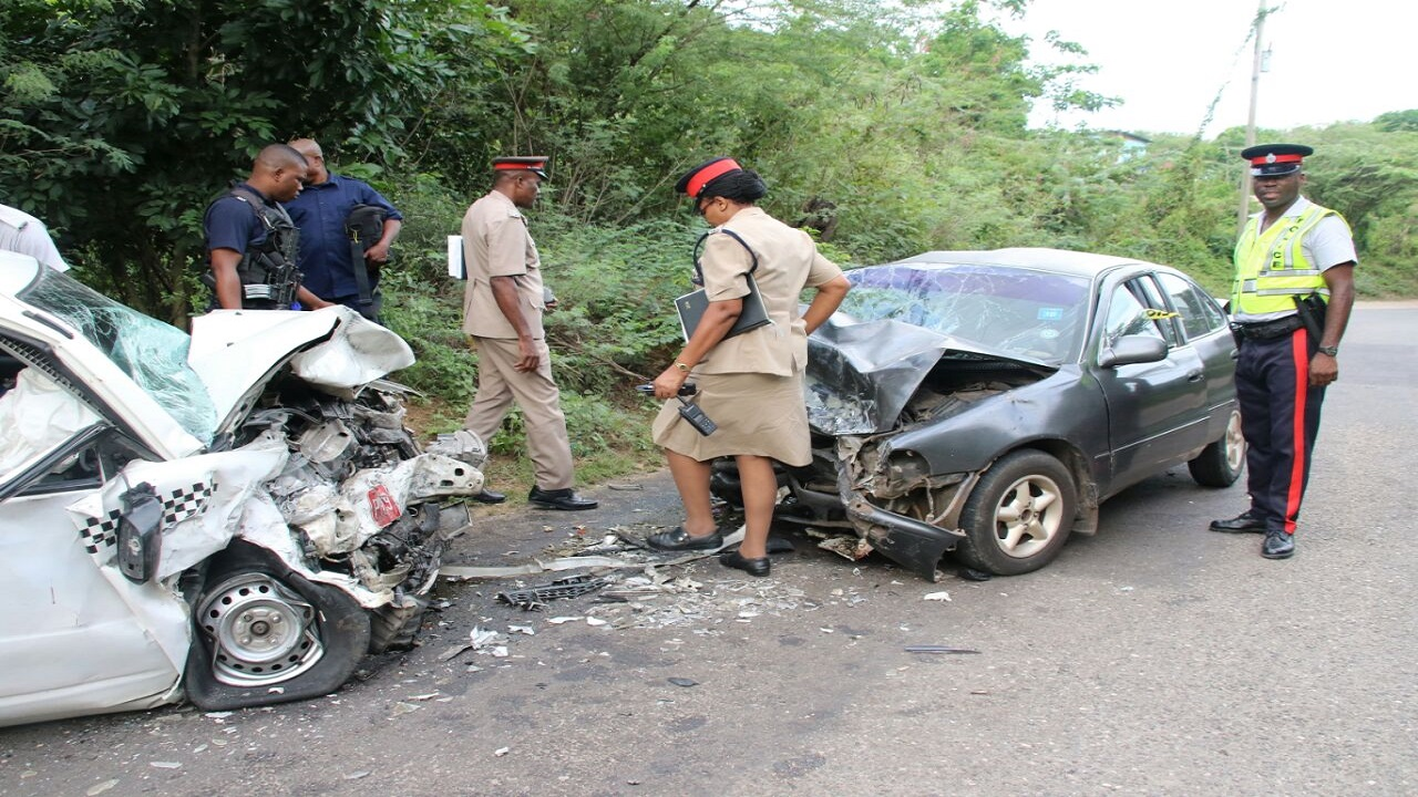 Police process the scene of the fatal accident in Clarendon on Thursday afternoon. (PHOTOS: Llewellyn Wynter)