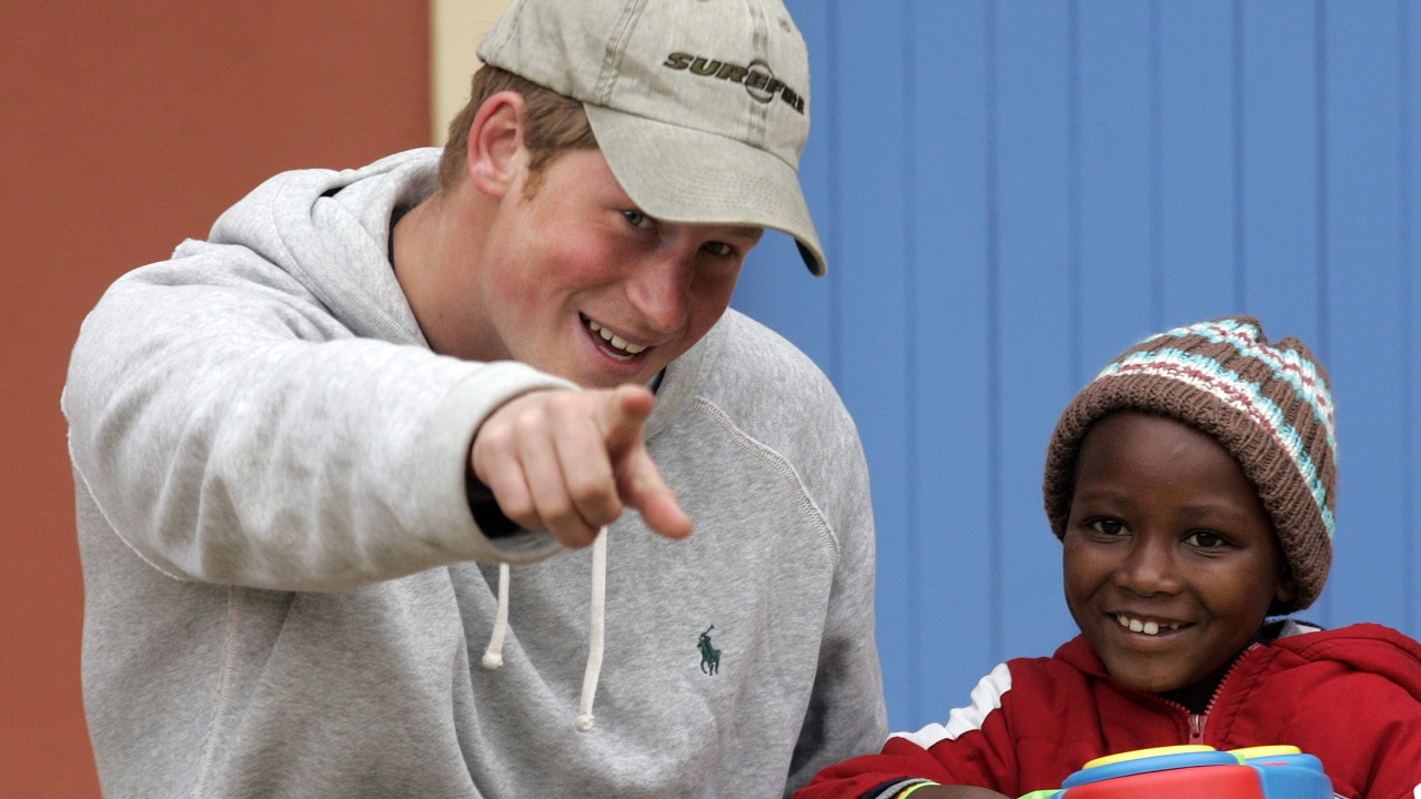 (Image: AP: Prince Harry jokes with a toddler at a centre for abused children in Maseru, Lesotho on 9 July 2008)