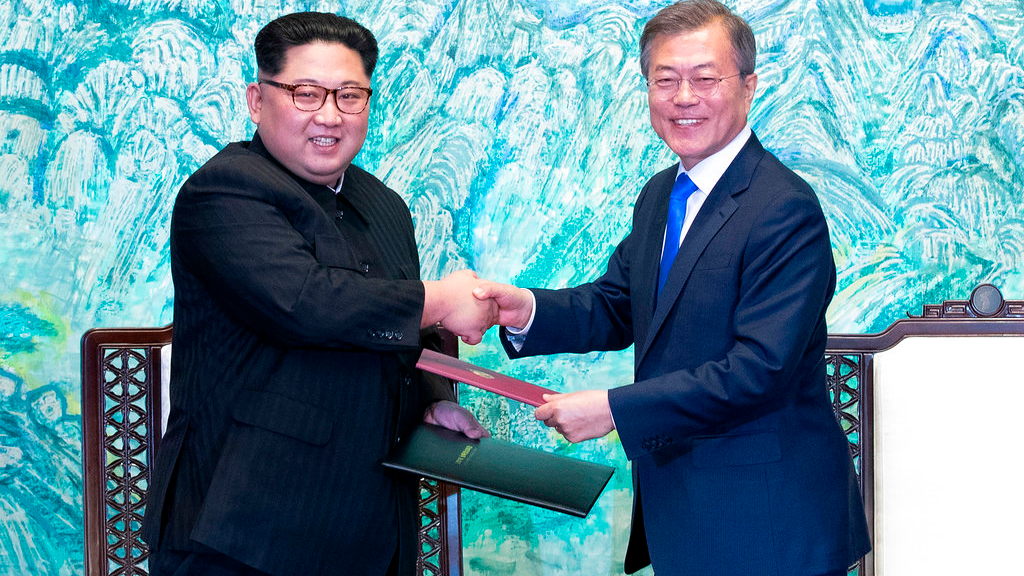 In this file photo, North Korean leader Kim Jong Un, left, and South Korean President Moon Jae-in shake hands after signing on a joint statement at the border village of Panmunjom in the Demilitarized Zone, South Korea. (Korea Summit Press Pool via AP)