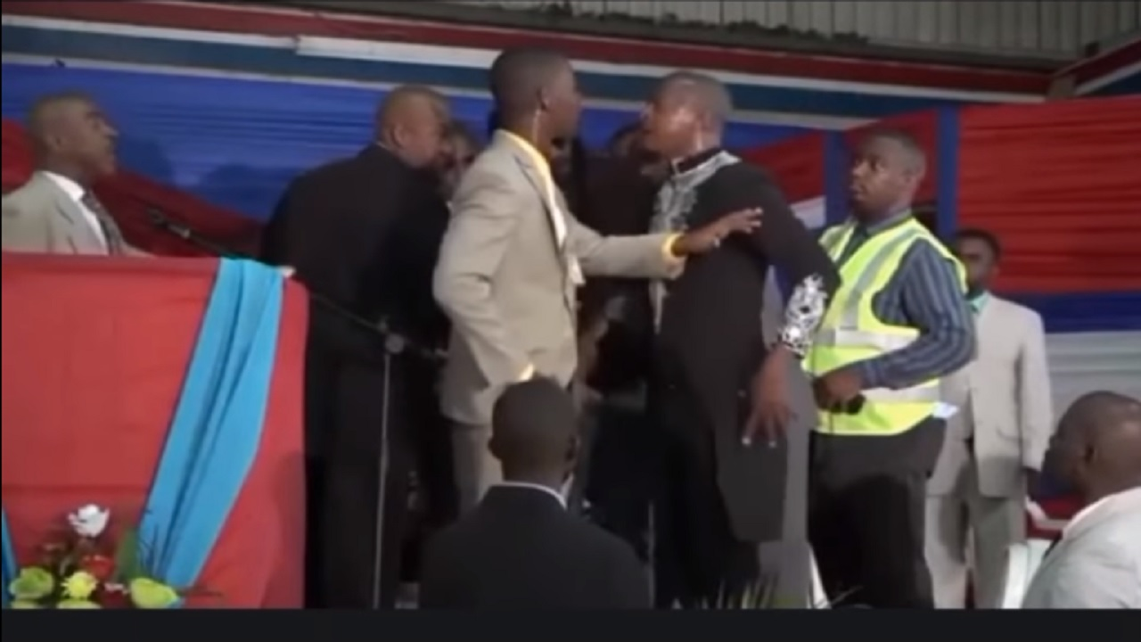 Screenshot of a video showing entertainer Mr Vegas (third right) being accosted by security guards while Pastor Gino Jennings (left), who issued the instructions to the officers, looks on.