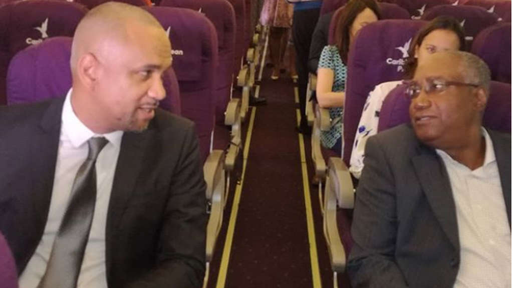 Garvin Medera, CEO of Caribbean Airlines and Keith Thomas, Chairman of the Airports Authority, try out the new seats available with the Caribbean Plus programme.