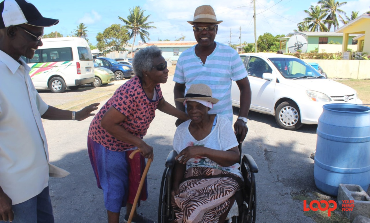 Doreen Payne, in the wheelchair, wanted to vote and her son Edward Payne made sure he was there.