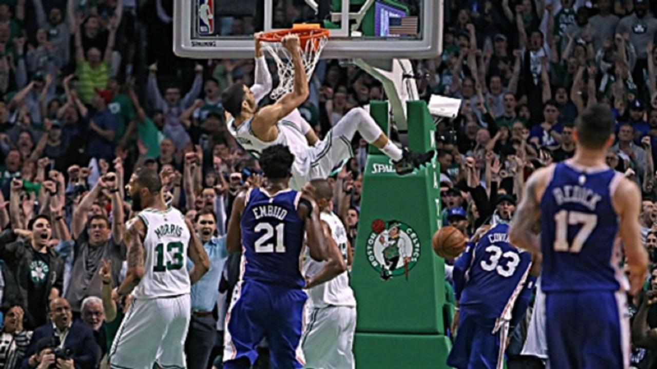 Jayson Tatum dunks.