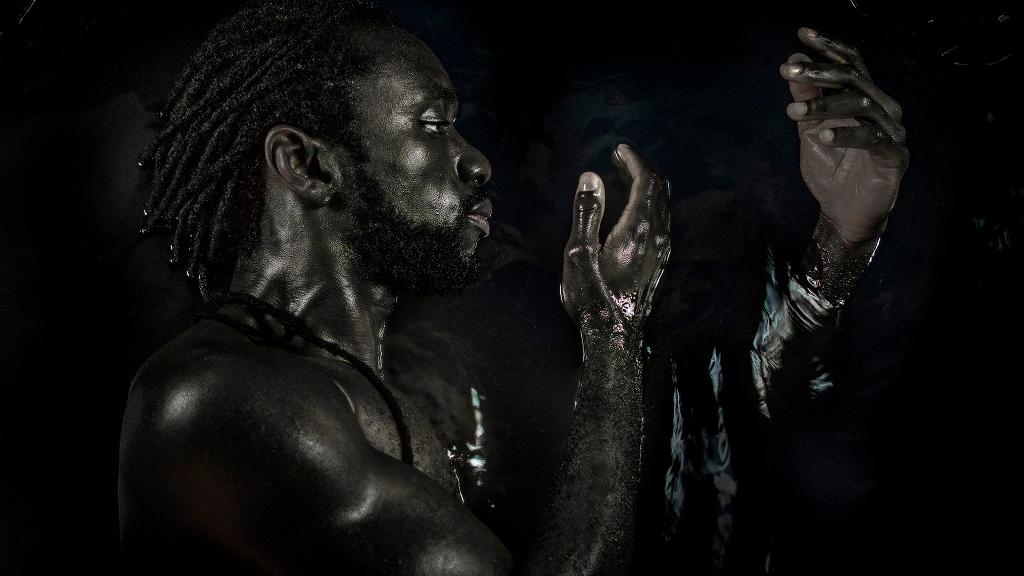 """Photo: """"Emancipation"""" - If I emerge, why is the Black Water still my shroud? Photo by: Keston Jack. Model: Kareem Jack."""