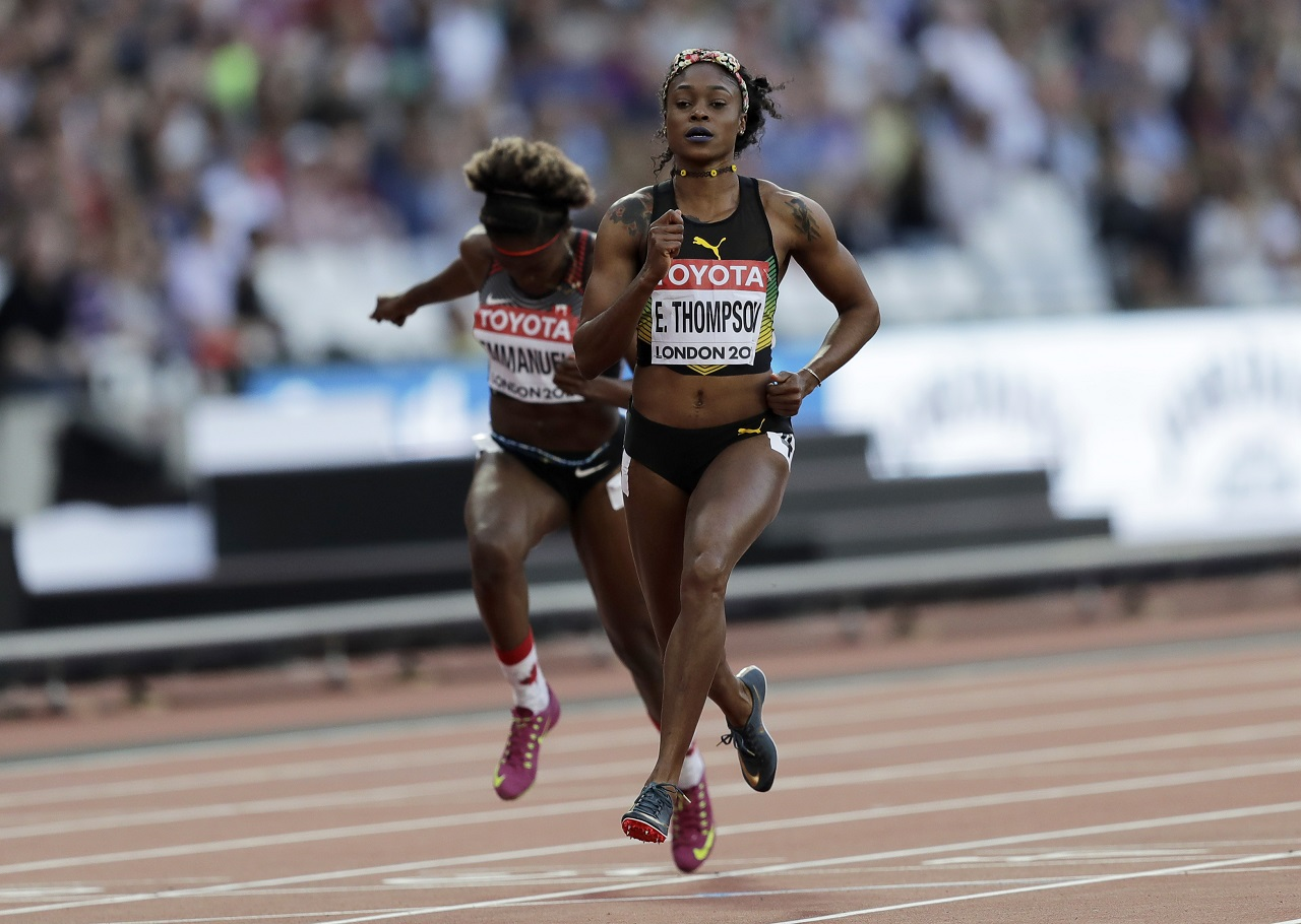 Jamaica's Elaine Thompson competes in a Women's 100 meters semifinal during the World Athletics Championships in London on Sunday, Aug. 6, 2017.