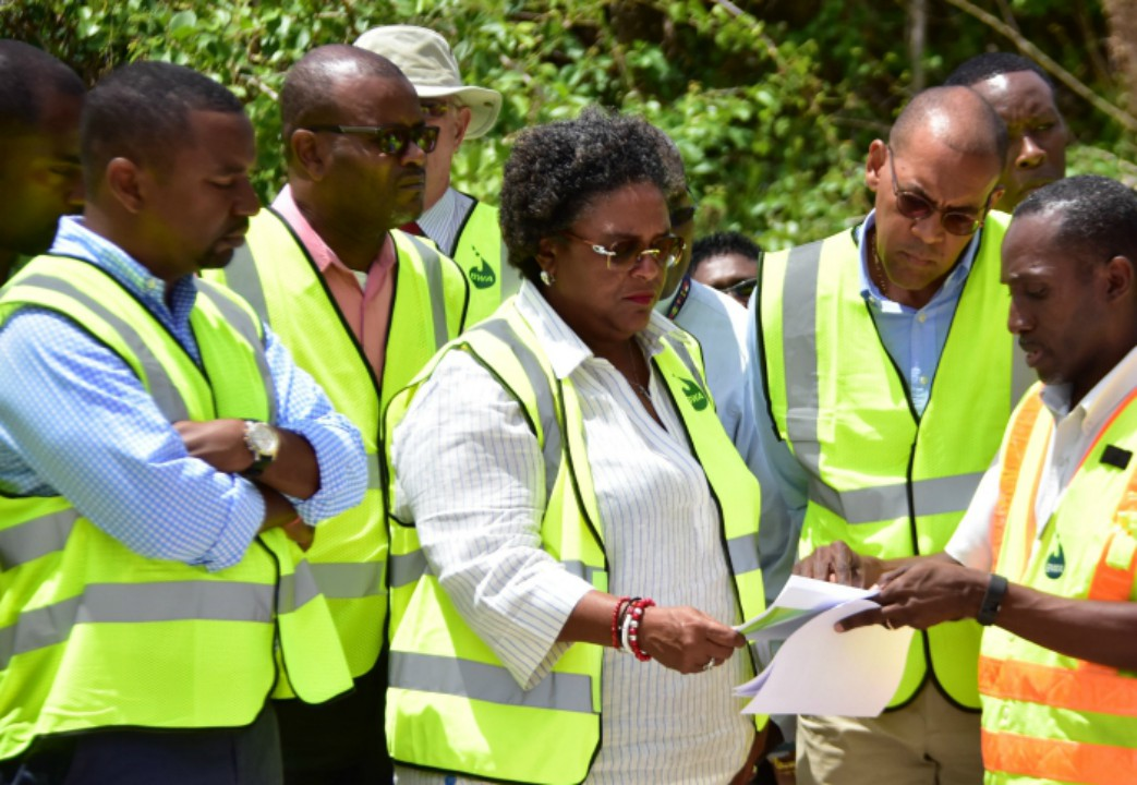 Charles Leslie (right), Director of Engineering (BWA) briefing Prime Minister Mia Mottley and members of her Cabinet (from left), Wilfred Abrahams, Peter Phillips and Kerry Symmonds, during this morning's tour of the south coast. (C.Pitt/BGIS)