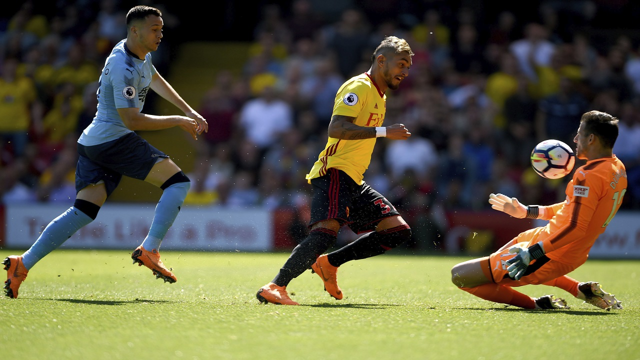 Watford's Troy Deeney takes a shot at a goal which is saved by Newcastle United goalkeeper Martin Dubravka during the English Premier League football match, at Vicarage Road, in Watford, England, Saturday May 5, 2018.