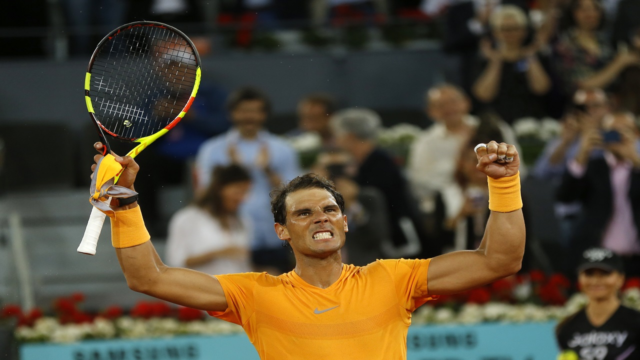 Rafael Nadal from Spain celebrates his victory over Diego Schwartzman from Argentina during a Madrid Open tennis tournament match in Madrid, Spain, Thursday, May 10, 2018. Nadal won 6-3, 6-4.