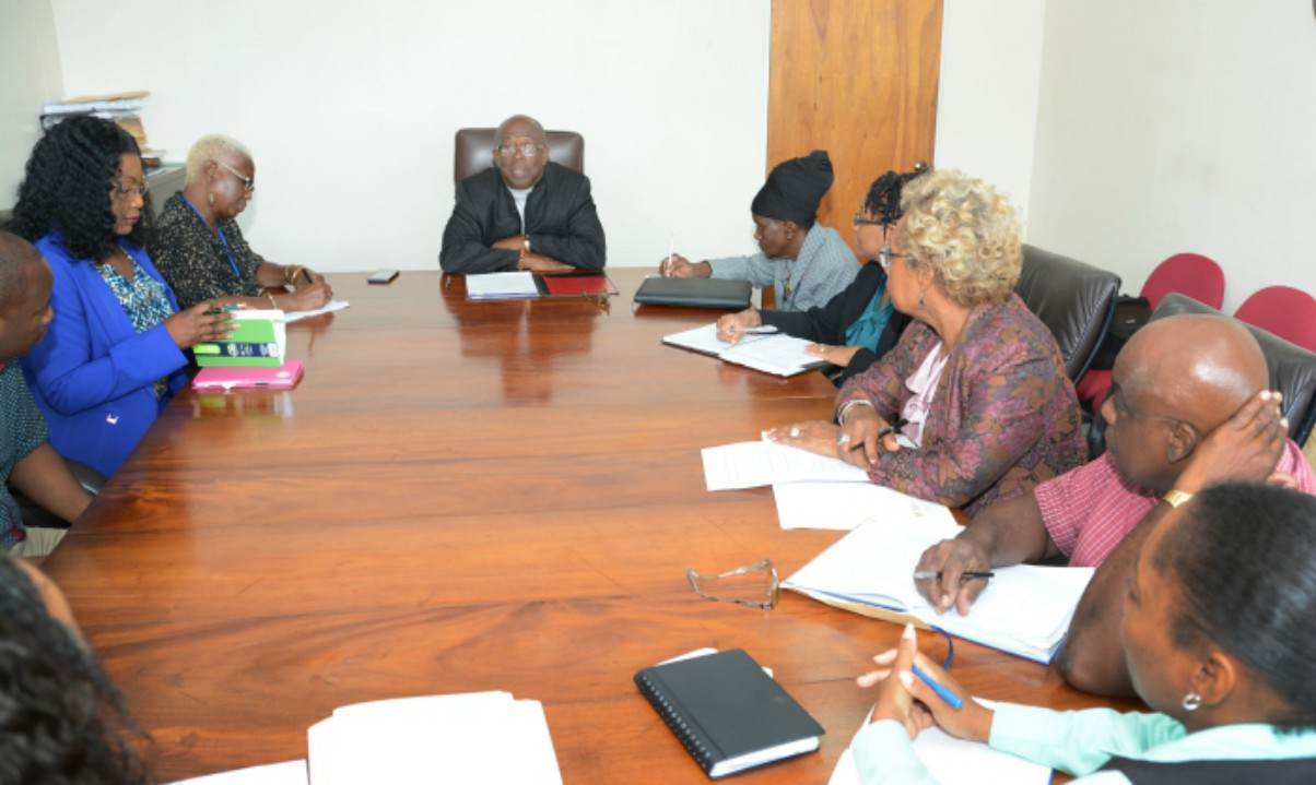 Minister of Environment and National Beautification, Trevor Prescod, (centre) during the meeting with Permanent Secretary in the Ministry, Daphne Kellman (right) his Personal Assistant, Cheryl Hunte (left), SSA Acting General Manager, Rosalind Knight and other officials on Monday. (B.Hinds/BGIS)