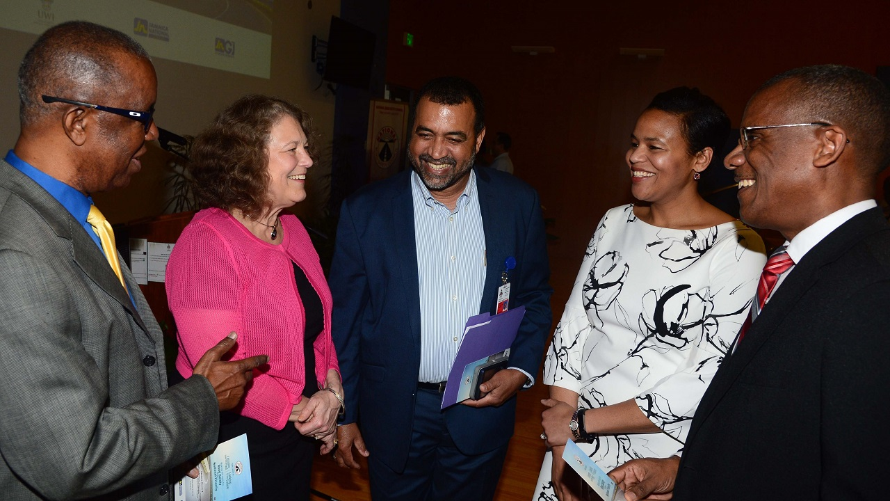 (From Left) Vice-Chairman of the National Road Safety Council (NRSC) Dr. Lucien Jones, Professor Andrea Gielen, UWI Consultant Psychiatrist Winston De La Haye, Professor Keshia Pollack, and Dean of the Faculty of Medical Sciences Dr. Tomlin Paul share a laugh following the public lecture.