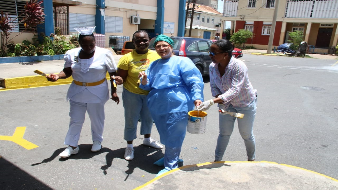 Health workers take a break from their Labour Day activities at the Victoria Jubilee Hospital in Kingston to pose for the Loop News camera. (PHOTOS: Llewellyn Wynter)