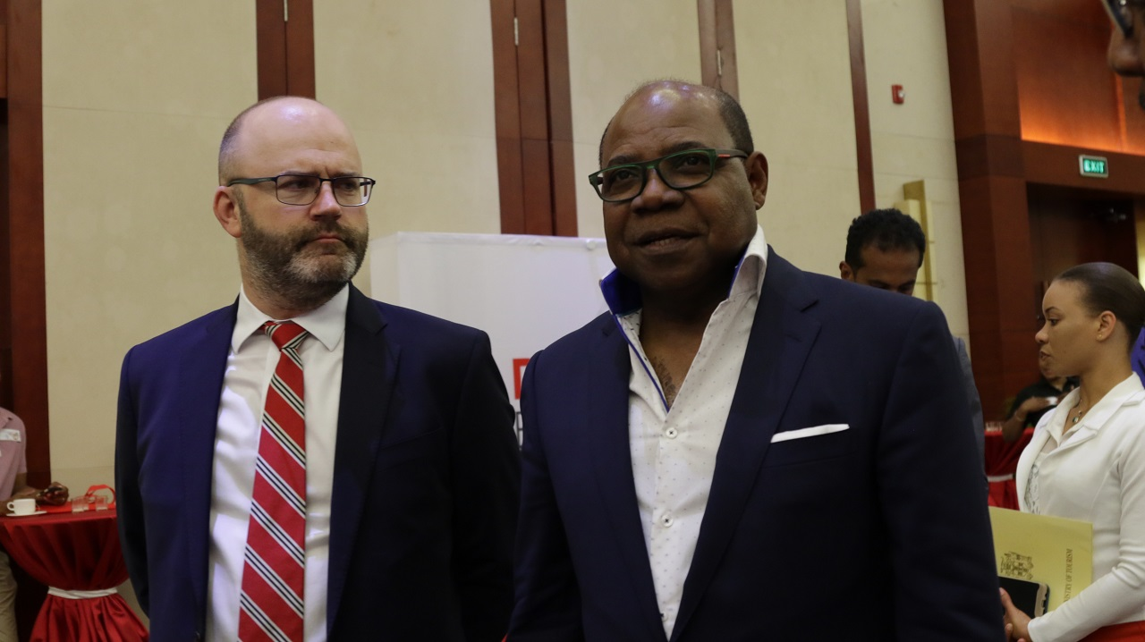 Tourism Minister Edmund Bartlett (right) with Digicel's Darragh Fitzgerald Selby, chairman of the Knowledge Network, at the Smart Destination 2018 workshop in Montego Bay, St James on Friday. (PHOTO: Ramon Lindsay)