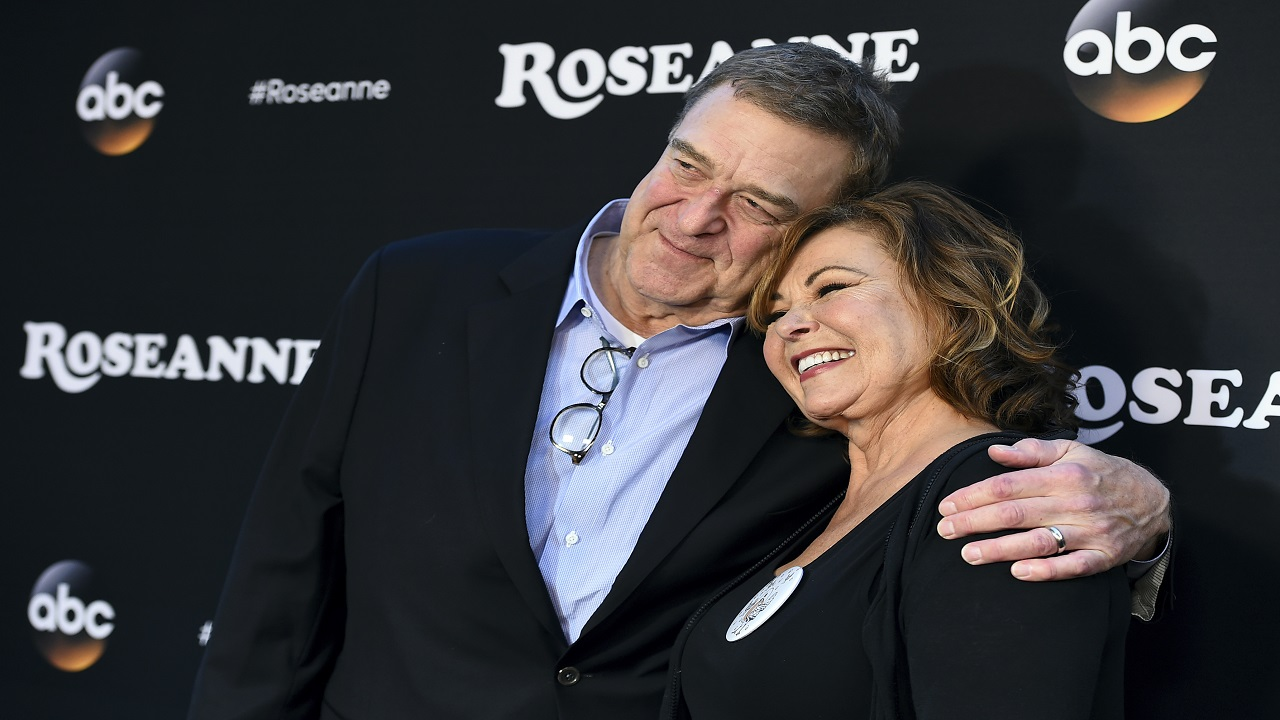 "FILE - In this March 23, 2018 file photo, John Goodman, left, and Roseanne Barr arrive at the Los Angeles premiere of ""Roseanne"" in Burbank, California. (Photo by Jordan Strauss/Invision/AP, File)"