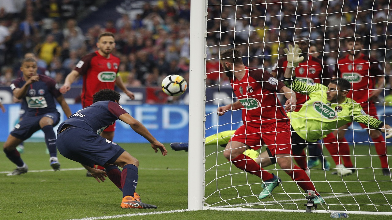 PSG's Marquinhos, left, passes the ball as Les Herbiers goalkeeper Matthieu Pichot prepares to save during the French Cup football final at the Stade de France stadium in Saint-Denis, outside Paris, Tuesday, May 8, 2018.