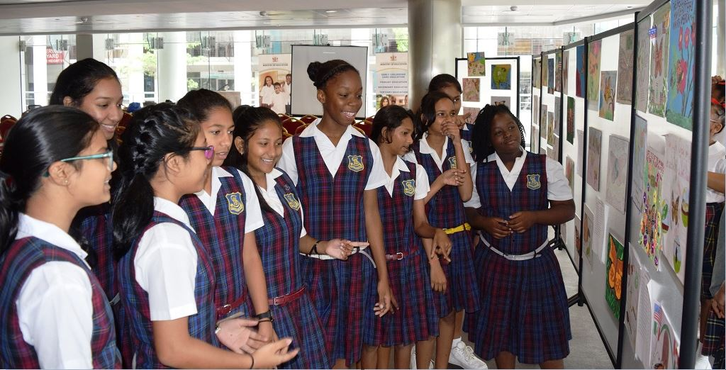 Students from St. Augustine Girls' High school (SAGHS) viewing the exhibition at MOE.