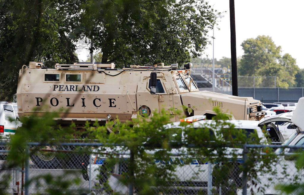 A Pearland Police armored vehicle stands ready in front of Santa Fe High School in Santa Fe, Texas, in response to a shooting on Friday morning, May 18, 2018.