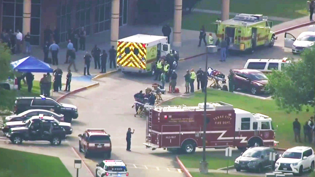 In this image taken from video emergency personnel and law enforcement officers respond to a high school near Houston after an active shooter was reported on campus, Friday, May 18, 2018, in Santa Fe, Texas. The Santa Fe school district issued an alert Friday morning saying Santa Fe High School has been placed on lockdown.