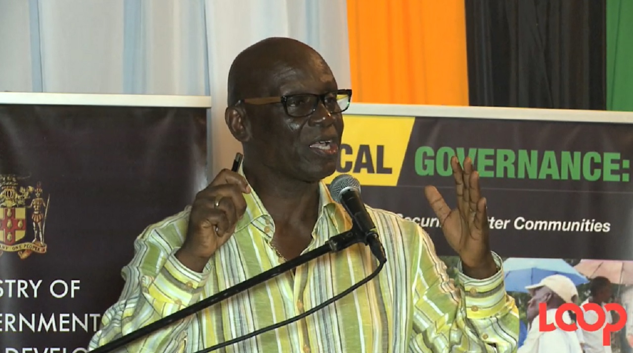 Local Government Minister Desmond McKenzie addresses residents of Portland at a town hall meeting held at the Errol Flynn Marina in the parish last week.