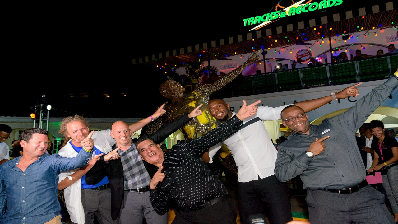 "(From left) Mark Hart, Representative of Crissa Entertainment Group, Franchisee of UBTR Montego Bay; Diedel Klover, Designer of the ""Bolt of Bolts"" statue, Gary Matalon, Franchise Owner of UBTR; MoBay Mayor Homer Davis, Olympian Usain Bolt and Donovan White, Director of Tourism at the launch on Wednesday."