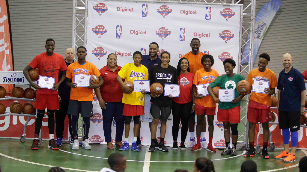 The Elite Camp winners, from left: Samuel Waldron, Nwadike Felix, Jelani Blackett, Daniel Constance, Breanna Charles, Nikita Baptiste and  Nickolai Mills, are with Marketing Executive of Digicel, Roshawn Campbell (fifth from right), the General Secretary of the National Basketball Federation of Trinidad and Tobago (fourth from left), and the NBA coaches, who are all smiles following the conclusion of the Digicel Jumpstart Clinic at the Centre of Excellence, Macoya on Sunday.