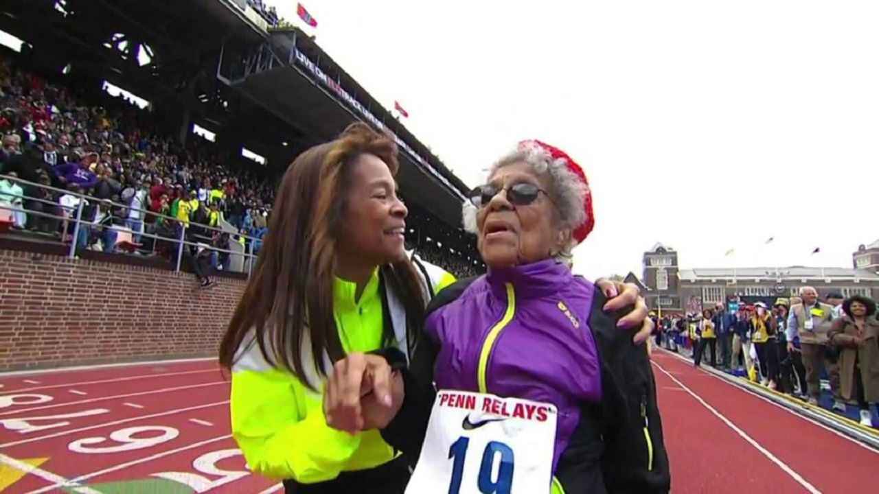 Ida Keeling is congratulated by her daughter Shelly Keeling after finishing the 100 meter dash at the 2016 Penn Relays. (PHOTO: AP)
