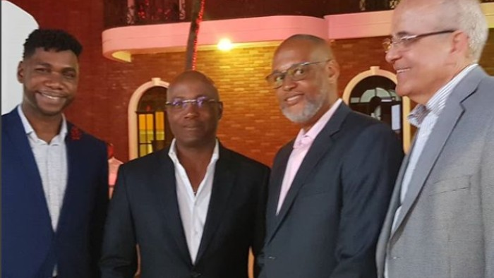 Brian Lara with Ferreira Optical Chairman Colin Ferreira (r), Sean Francis CEO, and Ian Marcus Lewis, Marketing Manager (l)