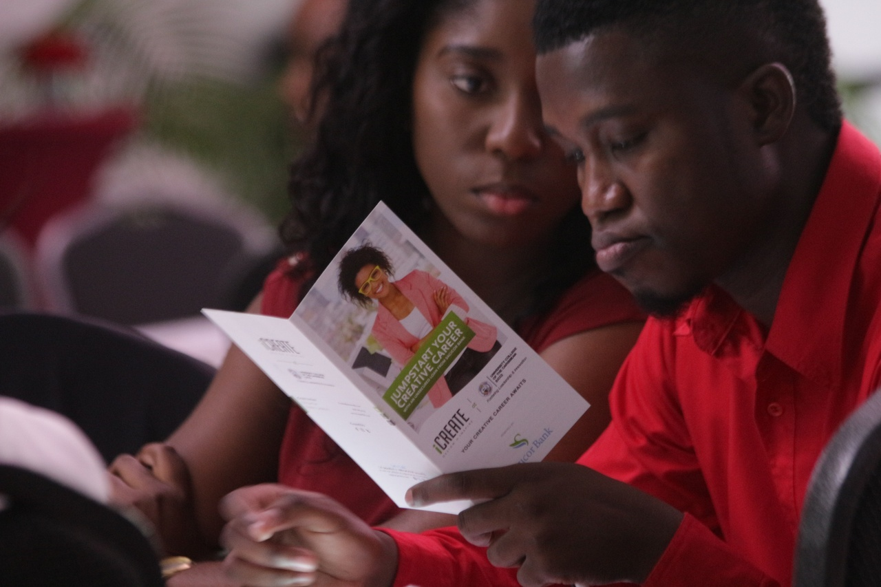 A participant at the recent Keep Growing conference looks through a booklet. (PHOTO: Marlon Reid)