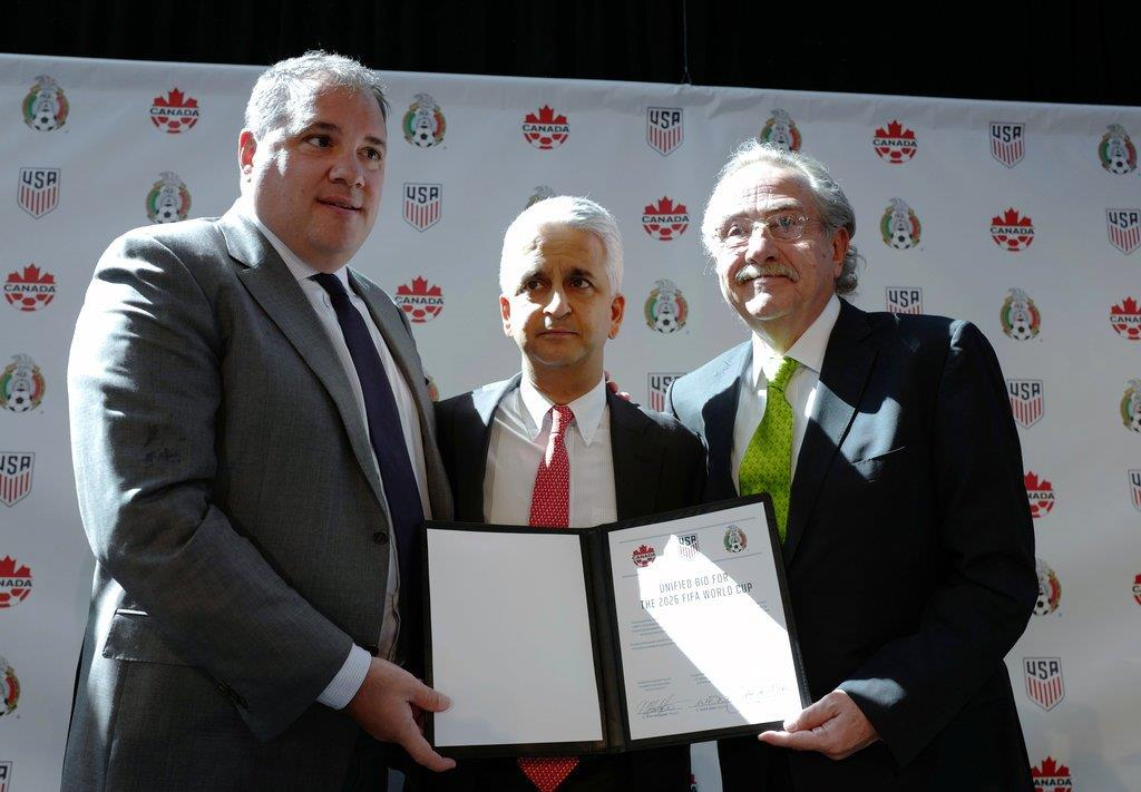 In this Monday, April 10, 2017, file photo, Victor Montagliani, left, President of the Canadian Soccer Association, Sunil Gulati, center, President of the United States Soccer Federation, and Decio de Maria, President of the Mexican Football Federation, show their unified bid to co-host the 2026 World Cup, in New York. FIFA has pledged to publish all votes by soccer officials in the 2026 World Cup bidding after corruption claims tainted the 2018-2022 contests.