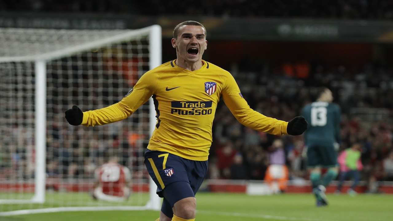 In this Thursday, April 26, 2018 file photo Atletico's Antoine Griezmann celebrates after scoring the first goal for his team during the Europa League semifinal first leg football match against Arsenal at Emirates Stadium in London.