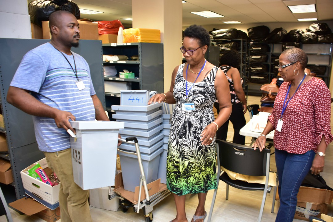 Electoral workers collect election materials, supplies and equipment ahead of tomorrow's General Elections.
