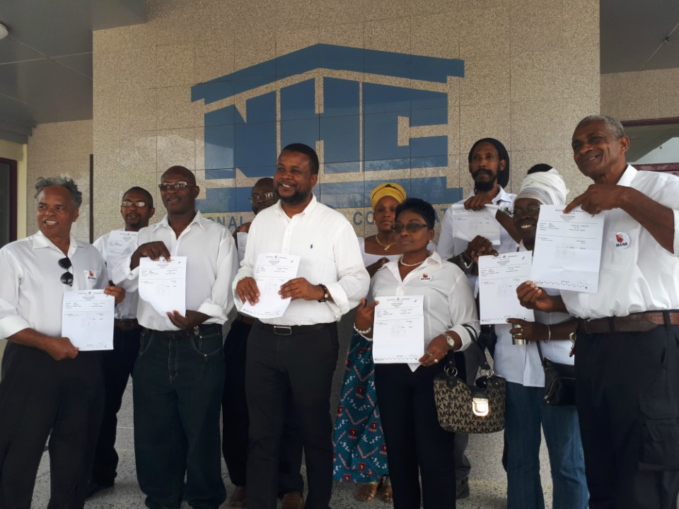 Candidates in the Barbados Integrity Movement (BIM) displaying their deposit papers.